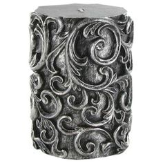 "This Antique Silver Embossed Swirl Pillar Candle is a beautiful candle and will make a wonderful accent in any room or for any occasion. The candle measures approximately 3"" x 4""."