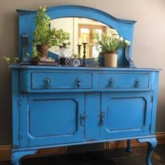 Beautiful dresser and mirror turned buffet painted with Chalk Paint® by Annie Sloan in the color Giverny | The bold blue color project is by Reloved by Me
