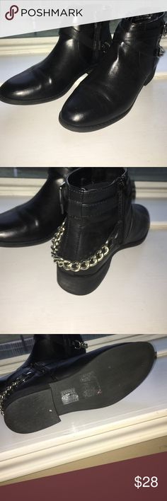 Black leather ankle boots Fux leather ankle boots with a chain on the back they zip up on the inside they've only been wore like 3 times I got them the wrong size their just like new Forever 21 Shoes Ankle Boots & Booties
