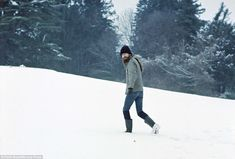 This 1973 shot shows a bearded George Harrison walking up a hill at his home in Friar Park...