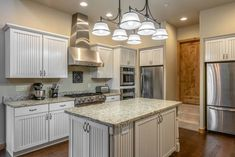 Refinishing kitchen cabinets may seem like a big project, but the process is actually surprisingly simple. Here's what you can expect.Picking between refinishing and replacing kitchen cabinets should … Replacing Kitchen Cabinets, Kitchen Cabinet Trends, Refinishing Cabinets, New Kitchen, New Kitchen Cabinets, Kitchen Trends, Open Floor Plan Kitchen, Simple Kitchen Cabinets, Rustic Kitchen