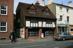 A double fronted property, which is arranged on ground, basement and two upper floors of timber frame construction, part rendered and part tile hung under a clay tiled roof with many period features.  The property forms part of the town centre Conservation Area.