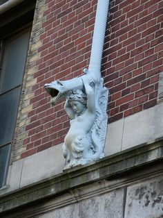 Mermaid Drain Pipe, Amsterdam  (not quite a gargoyle, but accomplishing the same purpose)