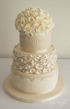 """Beautiful!   ~  Ivory and Champagne Wedding Cake made by """"Sugar Ruffles"""" ( on facebook)   ~ piped pearls on champagne icing, a billowed satin effect on the middle tier and ivory lace and is topped with a dome of ivory sugar roses."""