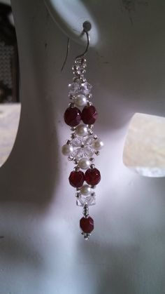 Swarovski crystals and white pearls with garnet Firepolished Crystals woven with seed beads. Hangs 2 3/4 from ears.