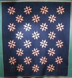 "Indigo Stars quilt from Pennsylvania, signed ""Susanna Johnson March 27, 1846"". The 28 star pattern is unique."