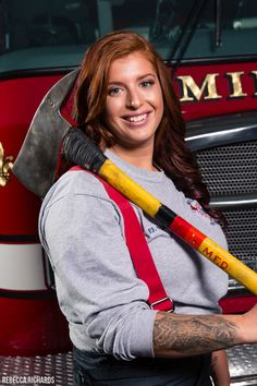 Female firefighter portraits with ax | senior girl firefighter | Rebecca Richards Photography