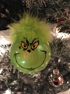 Grinch ornaments. Used a plain glass ornament and used mop and glo and green glitter...can find a million pins on how to do it. Cut the face out of vinyl using a cricut and glued part of a green boa for the hair.
