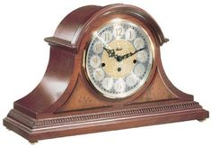 "21130-N90340 - Hermle Amelia Tambour Mantel Clock - Beautiful styled tambour clock in an elegant cherry finish. With brass feet, raised burl veneer panels and a beaded molding across the bottom. Brass 8-day key wound movement plays 4/4 Westminster chimes.  Measures: H 11 3/8"" x W 18 1/8"" x D 6 1/2""   Three year manufacturer's warranty    Free shipping from http://www.theisenclock.com/mantel_clock.html"