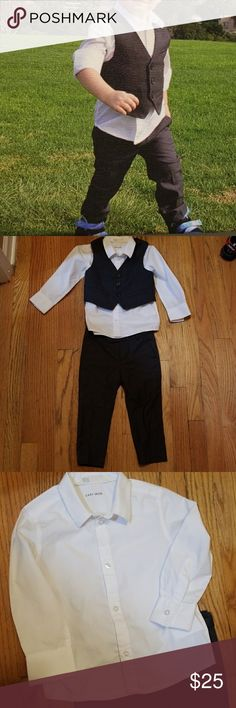 H&M 3 piece suit This outfit is perfect to get your little man ready for all those summer weddings you have coming up. He's sure to be the best dressed! My little guy got 2 weddings out of this outfit before growing out of it. Dark grey pants and vest, white button up shirt. There's a small stain on the white shirt. I'm sure it will come out with some bleach. It's hardly noticeable. All size 1 1/2-2 years. Adjustable pants. H&M Matching Sets