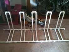 Bike Rack: This is a simple bike rack constructed from PVC pipe. Pvc Bike Racks, Diy Bike Rack, Bicycle Rack, Range Velo, Pvc Pipe Projects, Bike Storage, Garage Organization, Diy Furniture, Urban Furniture