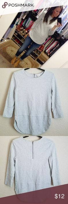 Gray Curved Hem Top Heathered gray 3/4 sleeve top with fun curved hem. Zipper detail in the back adds a unique twist to a nice basic. Made from a lightweight sweatshirt material making it perfect for multiple seasons. This style bloggers picture is what inspired the purchase but I only ended up wearing it a couple times EUC Tops Sweatshirts & Hoodies