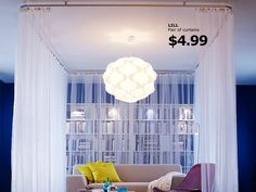 Create a room within a room with ceiling tracks and curtains (Ikea KVARTAL curtain rail system)