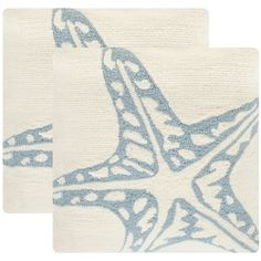 Bring the beach to your backyard with this breezy set of two starfish indoor outdoor pillows in an intricately textured white and baby blue hooked weave. Designed for lasting beauty, this fashion fabr