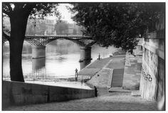 Cartier-Bresson... there is a sense of depth in the layers of paths by the side of the river. It makes the piece a little more interesting to look at as well as creating almost a 3D effect.