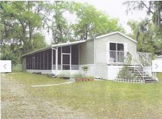 Mobile Home Remodeling Ideas 10x40 addition on side and replaced front window with sliding glass doors and made front entrance there along with new deck. Nice thinking!