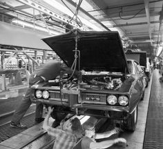 This photo from the Pontiac GTO assembly line shows the use of a very interesting fixture. It appears to be aligned by attaching itself to the Endura bumper. Hoping that someone with assembly plant experience can explain what is going on here. 1968 Pontiac Gto, Pontiac Cars, Gto Car, Old School Muscle Cars, Nascar Race Cars, Assembly Line, Old Classic Cars, Drag Cars, Small Cars