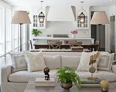 Rachel Halvorson Design :: Kitchen and Dining Eating Area with farmhouse dining table surrounded by French cafe dining chairs which opens up...