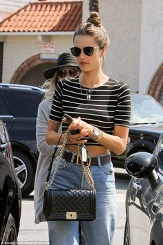 Top bunning: Ambrosio toted a black quilted Chanel purse with a chain handle during her ou...