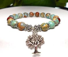 Popular tree of life gemstone bracelet made with 8mm Aqua Terra and an Antique Silver Tree of Life Charm. Simple and very pretty. Aqua Terra Jasper Properties: Also known as Variscite brings a calming