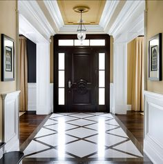 """Benjamin Moore  Paint Colors. Benjamin Moore """"Shaker Beige"""" HC-45 #BenjaminMoore #ShakerBeige #HC45 The foyer features a custom-cut Cambria quartz floor with contrasting inlay in a snappy black and white pattern, traditional millwork and a beautiful lantern by """"Union Lighting""""."""