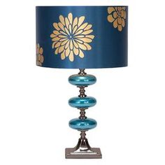 "Metal table lamp with a floral drum shade.       Product: Set of 2 table lamps   Construction Material: Glass, fabric and metal    Color: Blue, gold and silver    Features:     Beautiful glazed glass balls decorate the base   UL listed    Accommodates:  (1) 60 Watt max bulb - not included     Dimensions: Overall: 23"" H x 14"" DiameterShade: 9"" H x 14"" Diameter"