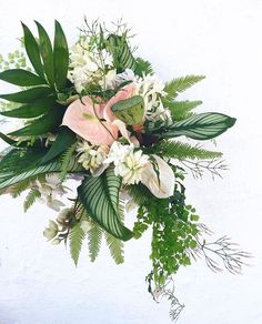Yesterday's bridal bouquet with jasmine, calathea, anthurium, lotus, hellebore, tuberose, phalaenopsis, and ferns