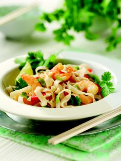 Cook 150g rice noodles in boiling water for 5 minutes, drain and cool.  Mix 1 red pepper finely sliced, 200g cooked, peeled tiger prawns, ½ bunch spring onions and 20g fresh coriander.    Whisk together the juice of 1 lime, 1 tbsp soy and 1 tsp fish sauce and toss into the salad, scatter over 25g unsalted peanuts and serve.