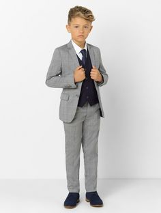 Shop our boys grey Prince of Wales check suit with navy waistcoat at Roco. Boys wedding suit and comes with free UK delivery & 30 day returns. Navy Grey Suit, Grey Suit Men, Grey Suits, Kids Wedding Suits, Trendy Outfits, Boy Outfits, Grey Check Suit, Suit Measurements, Checked Suit
