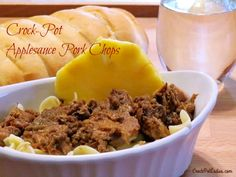 Crock-Pot Applesauce Pork Chops - Just 5 simple ingredients tossed in the slow cooker and you have this delicious recipe for Crock-Pot Applesauce Pork Chops. The pork chops come out so tender that they practically fall apart! | CrockPotLadies.com