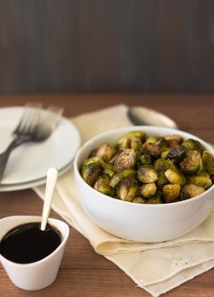Balsamic Roasted Brussels Sprouts - 5 minutes of prep time, totally healthy, and loaded with flavor. A perfect side dish for Thanksgiving or any meal! brighteyedbaker.com