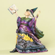 The Collectors Hub - Jim Shore Witch with Spell Book Figurine, $54.95 (http://www.thecollectorshub.com/jim-shore-witch-with-spell-book-figurine/)