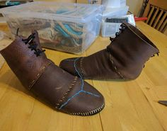 Aloy's moccasins and a tote of costume. This costume is actually quite comfortable to wear, though a - bytheninedesigns