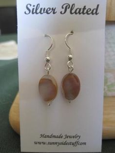 SILVER PLATED EARRINGS WITH MOTHER PEARL BEADS. FREE SHIPPING