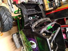 Converting 24v Grave Digger Power Wheels Into an Electric Go-kart With Rubber Tires : 11 Steps (with Pictures) - Instructables Brake Rotors, Brake Calipers, Grave Digger Power Wheels, Monster Truck Toys, Electric Go Kart, Steel Bar, Rubber Tires, Pictures, Photos