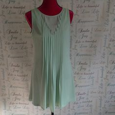C. Luce Dress C. Luce dresses with mod cloth.  Beautiful sheer pastel lime green dress with pleated front.  Green polyester lining.  Invisible zipper in seam.  Very airy and fun for spring and summer.  This is a very short dress.  Great paired with heels or sandals. Dresses