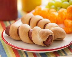 Spiral hot dogs #camping recipe: 8 prepared crescent rolls, 8 hot dogs. Roll crescent rolls into 15-inch ropes and twist around hot dogs, securing the ends. Insert a long skewer into the end and cook over the campfire.