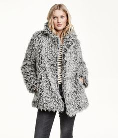 Jacket in shaggy faux fur with notch lapels, concealed hook-and-eye fasteners, and side pockets. Lined.