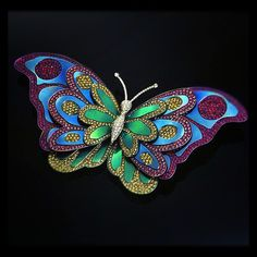 Beautiful titanium butterfly by Andreoli.    http://www.andreoliusa.com/
