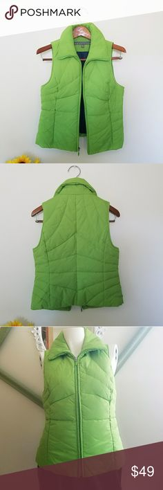 """Kenneth Cole Reaction Vest Gently worn. Fitted silhouette. Color green with navy blue liner. Zipper front closure. Zipper side pockets. Puffer style vest. No rips, holes, or stains. Sleeveless.  Measurements Length 22.5""""  Bust 35"""" - 36"""" Waist 27.5"""" - 28.5""""   Make an offer. Always willing to negotiate. Kenneth Cole Reaction Jackets & Coats Vests"""