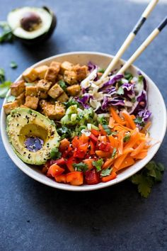 Easy Vegan Spring Roll Bowls with Crispy Tofu: Fresh, flavorful, and super simple! These Vegan Spring Roll Bowls are the perfect vegan lunch or dinner for spring and summer!    fooduzzi.com recipe #vegan #springroll #easydinner #vegetarian