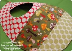 quilted bib - not loving these fabric choices, but looks like a fun project for fabric scraps
