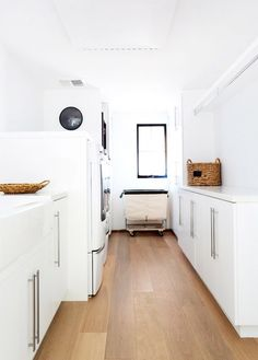 white laundry room Designer's Bohemian Malibu Home via White Laundry Rooms, Small Laundry, Style Me Pretty Living, Malibu Homes, Apartment Makeover, Laundry Room Design, Design Room, House Design, Wooden Flooring