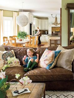 Blue, green, brown, white, tan. I'm also loving the variety of textures: Leather couch, rustic wood table, paper lantern, antique keys, hardwood floors, fuzzy carpet, textured pillows, crisp cotton curtains, etc.