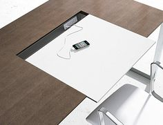 Merino Collection by Nucraft; leather blotter with plug-in for technology