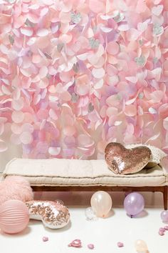 This backdrop is ready to ship! This gorgeous pastel paper garland backdrop would be a stunning accent for birthdays, weddings, or any other special occasion. This airy garland captures light beautifully to create a whimsical backdrop for any event. The display features a mixture of