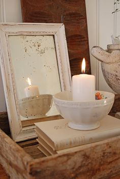 Like this for the mantel: a pretty bowl, a candle and a leaning mirror...reflect the light