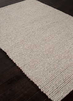 Many different methods of construction make up this textural chunky rug.  blanket your floor with this un-dyed wool for cozy comfort.
