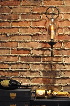 Graceful Loop Sconce in antique burnished brass with heavy verdigris glaze and clear glass, S2612V. — at Wine Room.