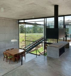 Hillside House with 2 Concrete Volumes, 2nd Story Entrance, Bridge